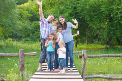 Happy young family with four children Stock Photos