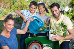 Happy young family gardening together Stock Images