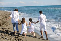Happy young  family have fun on beach Stock Images