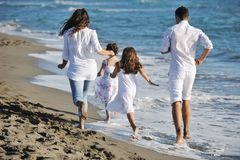 Young  family have fun on beach Royalty Free Stock Images