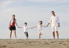 Happy young family have fun on beach Royalty Free Stock Images