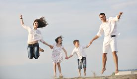 Happy young family have fun on beach Stock Photo