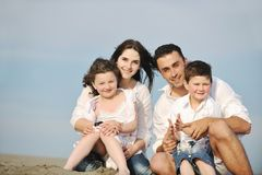 Happy young family have fun on beach Stock Photography