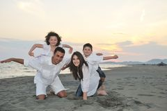 Happy young family have fun on beach Royalty Free Stock Image
