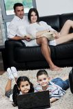 Happy young family have a fun with laptop at home Stock Photography