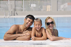 Happy young family have fun on swimming pool Stock Photography