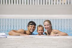 Happy young family have fun on swimming pool. At summer vacation Royalty Free Stock Image