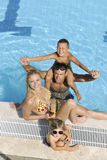 Happy young family have fun on swimming pool. At summer vacation Stock Images