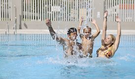 Happy young family have fun on swimming pool. At summer vacation Royalty Free Stock Photos