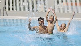 Happy young family have fun on swimming pool. At summer vacation Royalty Free Stock Images