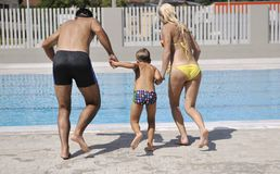 Happy young family have fun on swimming pool Royalty Free Stock Photos