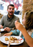 Happy young family having breakfast in the cafe. Portrait of happy young family having breakfast in the cafe Stock Photography