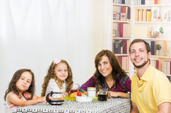 Happy young family having breakfast together Stock Images