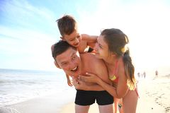 Family of four having fun at the beach. Stock Images