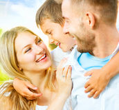 Happy young family having fun outdoors royalty free stock photo