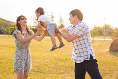 Happy young family having fun outside in summer nature Stock Photos