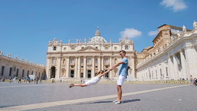 Happy young family having fun at St. Peter's Basilica church in Vatican city, Rome. Happy travel father and little girl. Happy family in Vatican city and St stock footage