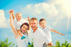 Happy young family having fun together stock photography