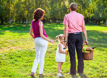 Happy young family having picnic at meadow Stock Photo