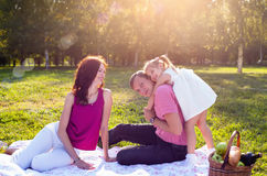 Happy young family having picnic at meadow. At summer day, very happy child Stock Photos
