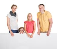 Happy young family holding banner Stock Photo