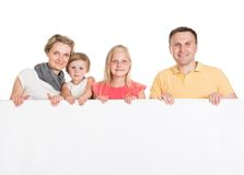 Happy young family holding banner stock photography