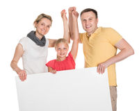Happy Young Family Holding Banner Stock Images