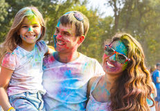 Happy young family on holi color festival Stock Photo