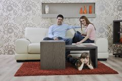 Happy young family at home Royalty Free Stock Images