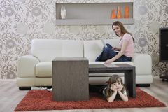 Happy young family at home Stock Image