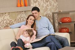 Happy young family at home royalty free stock photography