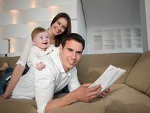 Happy young family at home Royalty Free Stock Photos