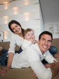 Happy young family at home Stock Photo