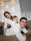 Happy young family at home Stock Photos