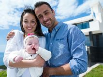 Happy young family at home Stock Photography