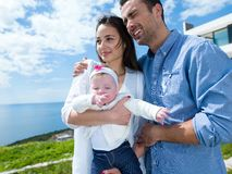 Happy young family at home Stock Images