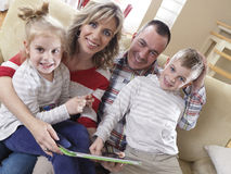 Happy young family at home Royalty Free Stock Image