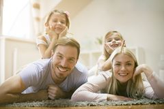 Happy young family at home. royalty free stock photography