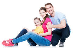 Happy young family with kid sitting. Royalty Free Stock Photos