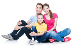 Happy young family with kid sitting. Stock Photos