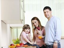 Happy young family in kitchen Stock Image