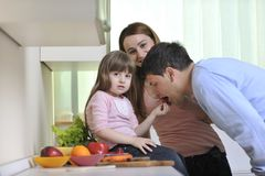 Happy young family in kitchen Stock Images
