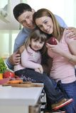 Happy young family in kitchen Royalty Free Stock Images