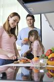 Happy young family in kitchen Stock Photo