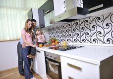 Happy young family in kitchen Stock Photography