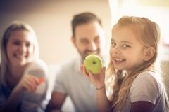 Holding green apple in hand. royalty free stock photography