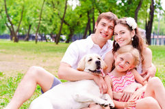Happy young family with Labrador Royalty Free Stock Image