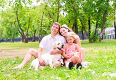 Happy young family with Labrador Royalty Free Stock Photography