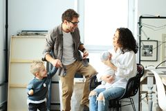 Happy young family laughing and dancing stock image