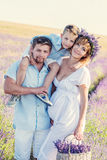 Happy young family in a lavender field Stock Images